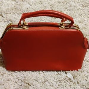 Charming Charlie red and gold structured purse